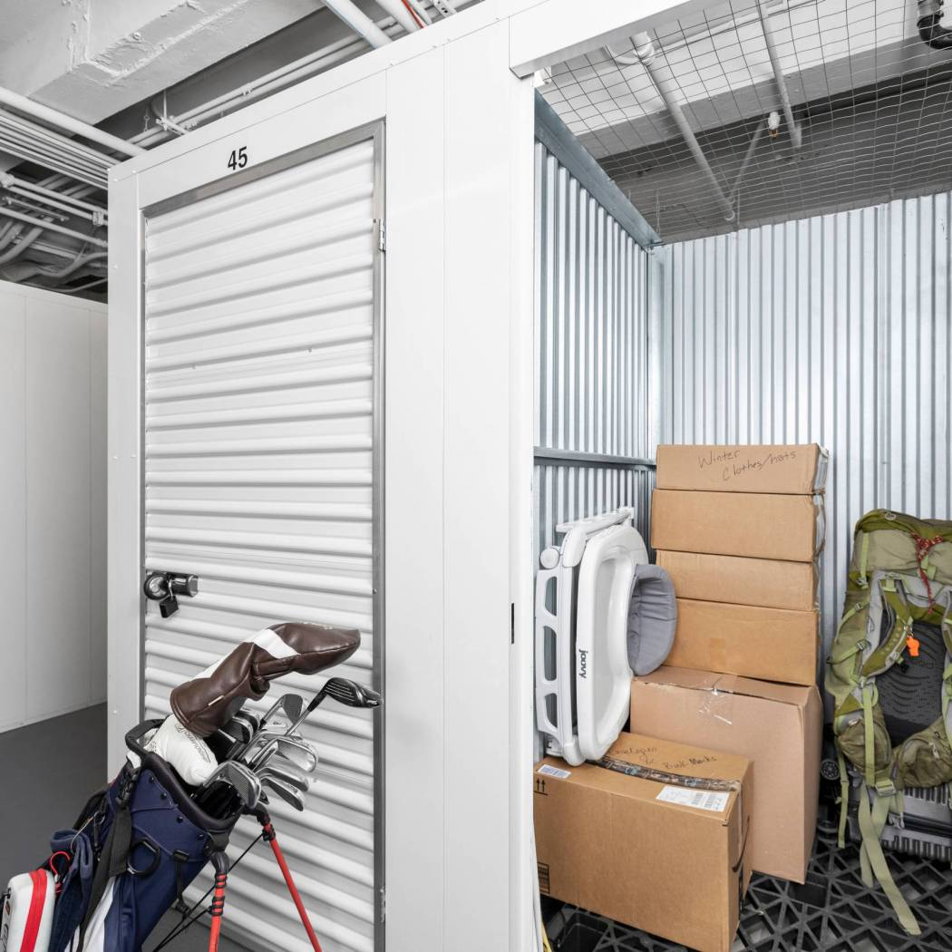 Storage unit packed with baby items, boxes and sports equipment
